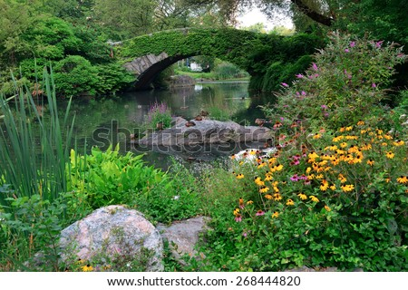 Central Park Spring with bridge in midtown Manhattan New York City - stock photo