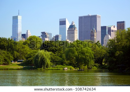 Central Park, The Lake and Manhattan skyline, New York - stock photo