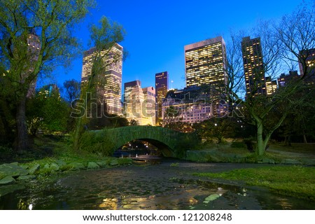 Central Park with Manhattan skyline at dusk, New York City - stock photo