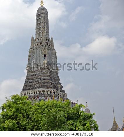 Central prang (spire) of Wat Arun (Temple of Dawn) in Bangkok, Thailand - stock photo