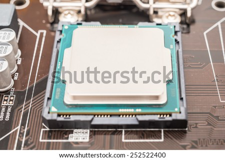 Central Processing Unit (CPU) Chip Installed On Motherboard Socket - stock photo