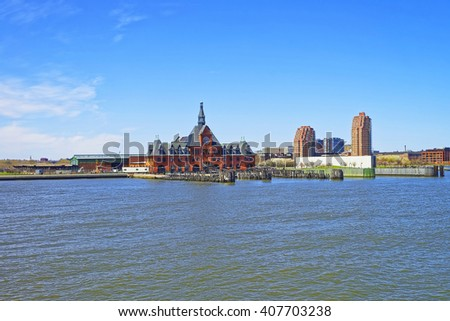 Central Railroad of New Jersey Terminal in USA. Hudson Waterfront. The Hudson River. Ferry slips serving boats. - stock photo