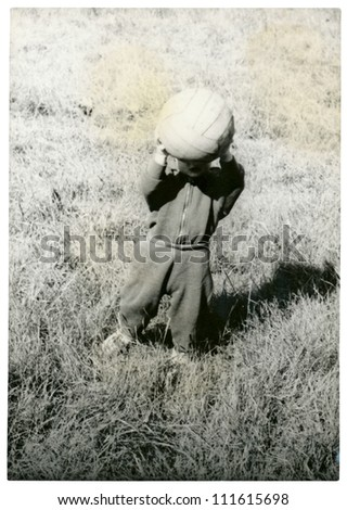 Central Slovakia, CZECHOSLOVAK REPUBLIC, CIRCA 1975 - kid with white ball - circa 1975 - stock photo