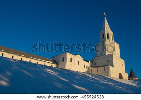 Central tower and main entrance to Kazan kremlin - Spasskaya tower with big clock and belfry in early cold winter morning - stock photo