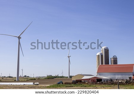 Central Wisconsin, USA - May 22, 2012: Wind Turbines Next to a Wisconsin Dairy Farm.   - stock photo