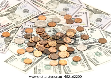 Cents coins on the dollars banknotes as background - stock photo
