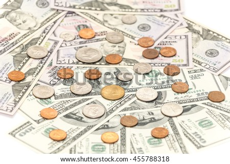 Cents coins on the  hundred and fifty dollars banknotes - stock photo