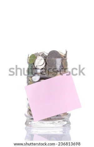 cents collected in a glass jar on white background - stock photo