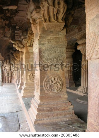 Centuries-old statue and carvings in the world famous Badami Caves in Karnataka, India.