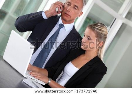 CEO and assistant - stock photo