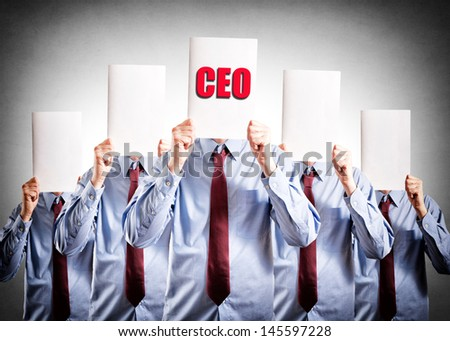 CEO holdings paper over his heads - stock photo