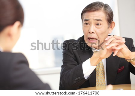 CEO of company discussing during a meeting - stock photo