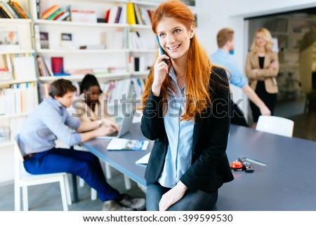 CEO of company making important phone call in modern office - stock photo