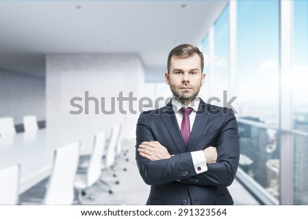CEO with crossed hands in the modern conference room. A concept of successful business. Panoramic office, New York City view. - stock photo