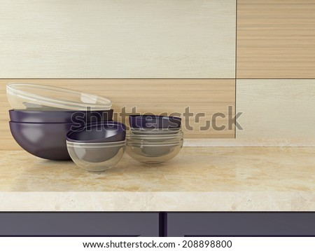Ceramic and glass kitchenware on the marble worktop. - stock photo