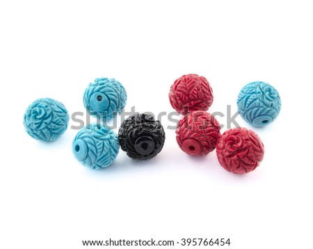 Ceramic beads multi colored on a white backgrund. - stock photo