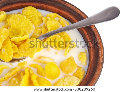 Ceramic bowl filled with corn flakes and milk. White background