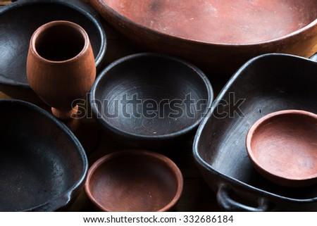 Ceramic brown handmade pottery earthenware utensil, kitchenware. background - stock photo