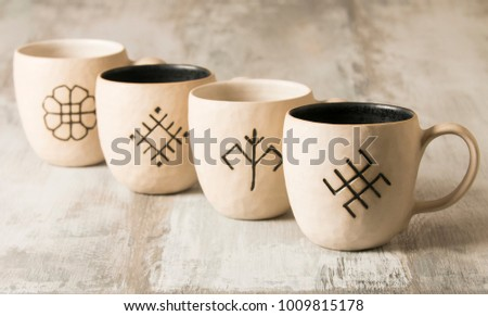 Ceramic cup handmade ceramic cup on a vintage wooden background
