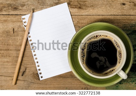 Ceramic cup of coffee with white blank paper and pencil