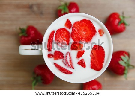 Ceramic Cup of Milk,Red Fresh Strawberries on the Wooden Background.Breakfast Organic Healthy Tasty Food.Cooking Vitamins Ingredients.Summer Fruits.Selective Focus,Top View - stock photo