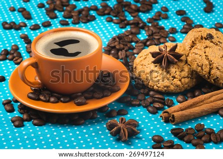 ceramic cup with coffee espresso on a bright blue background, oatmeal cookies, cinnamon, star anise,  top view, have a nice day, good morning - stock photo