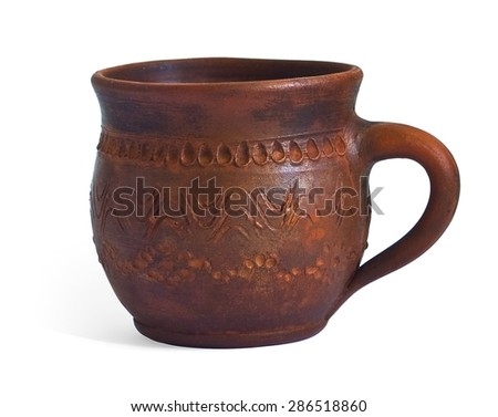 Ceramic cup with hand made ornament isolated on white background - stock photo