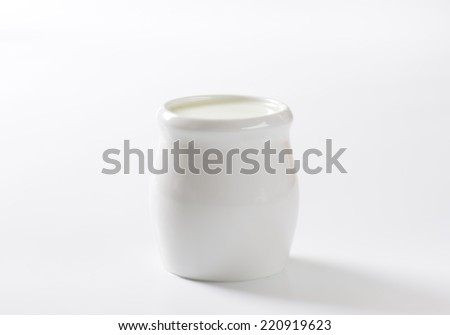 ceramic cup with milk to the coffee