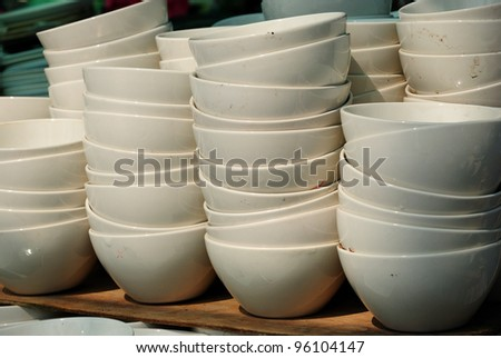 ceramic cups in a basket at the fair