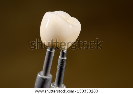 ceramic dental crown, tweezers