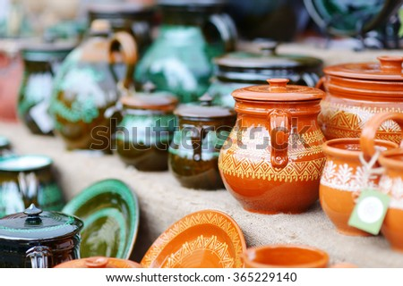 Ceramic dishes, tableware and jugs sold on Easter market in Vilnius, Lithuania - stock photo