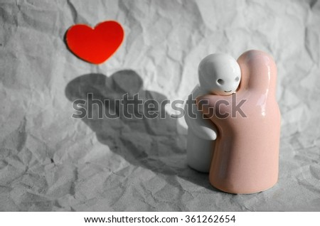 Ceramic dolls hugging  in a moment of love, Valentine background