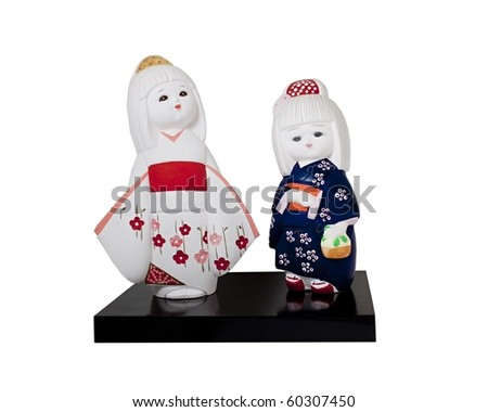 Ceramic dolls of two young japanese girls in kimonos