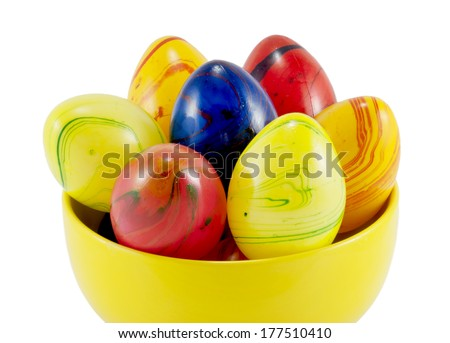 Ceramic easter eggs in the yellow bowl on a white background.