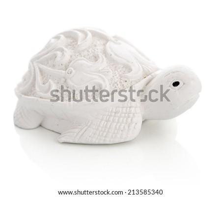 Ceramic figurine of turtle isolated on white background - stock photo