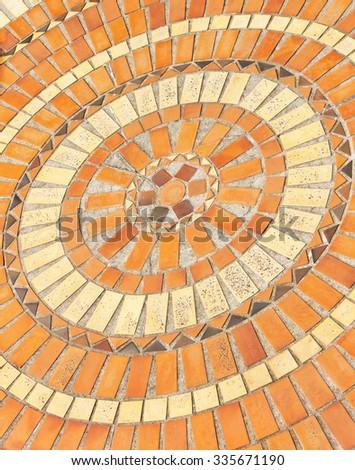 Ceramic floor - broken - old - circles in different colors - stock photo