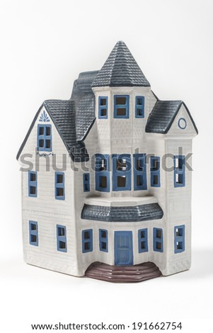 Ceramic house model Blue painted house symbolizing our need to be at home  - stock photo