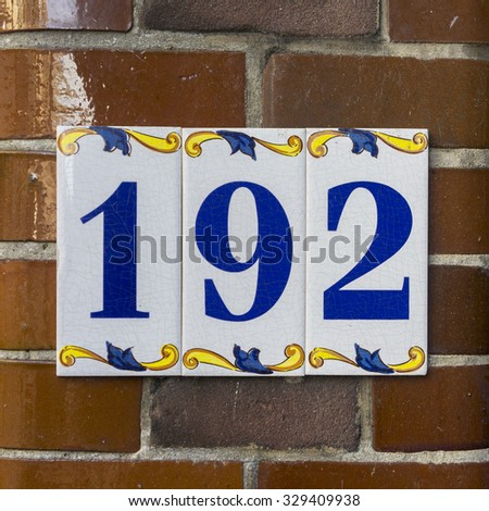 ceramic house number one hundred and ninety two - stock photo