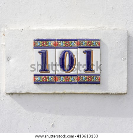 Ceramic house number one hundred and one - stock photo