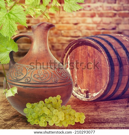 Ceramic jug and grapes on the table. Wine concept.