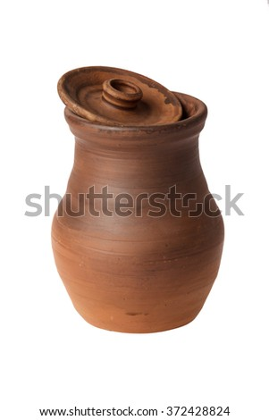 Ceramic jug with the lid removed on a white background - stock photo