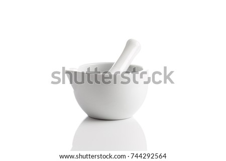 Ceramic mortar and pestle on a white background