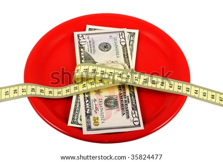 Ceramic plate with money and measuring tape. Symbolize a diet and the control over meal.
