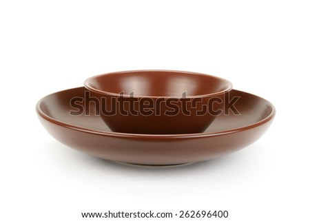 Ceramic plates isolated on a white background - stock photo