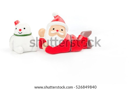 Ceramic Santa Claus and snowman on white background