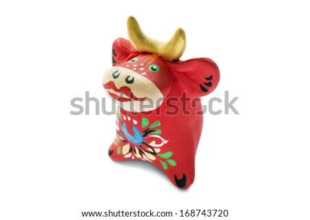 Ceramic souvenir statuette of red cow on white background - stock photo
