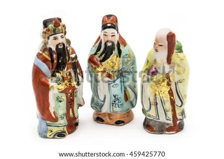 Ceramic Statue of Chinese Gods isolated on white background; God of Fortune (Fu,Hok), God of Prosperity (Lu,Lok), and God of Longevity (Shou,Siu)