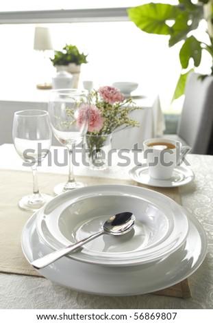 Ceramic tableware and Soupspoon - stock photo