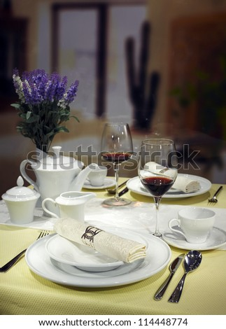 Ceramic tableware on the table - stock photo