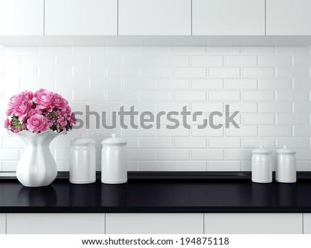Ceramic tableware on the worktop. Black and white kitchen design. - stock photo